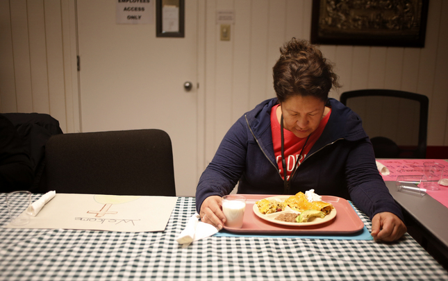 "Irene Lopez, 41, takes a moment in prayer at the dinner table at the Holy Spirit Church in San Jose, Calif., on Thursday, Jan. 28, 2016. Three San Jose churches that will shelter, feed and help homeless women rebuild their lives over three months. All of them are ""medically fragile"" women selected by Catholic Charities. (Josie Lepe/Bay Area News Group)"